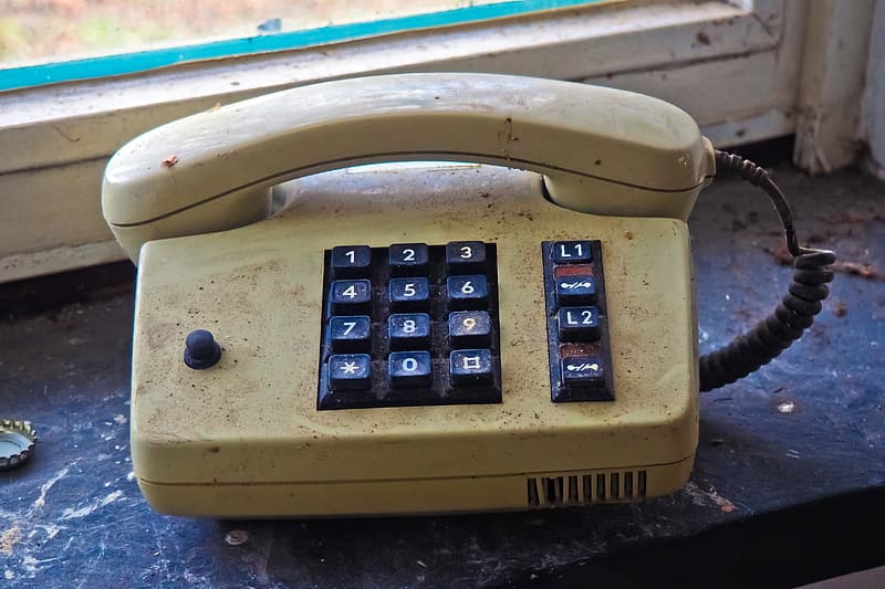 Beige and black corded home phone