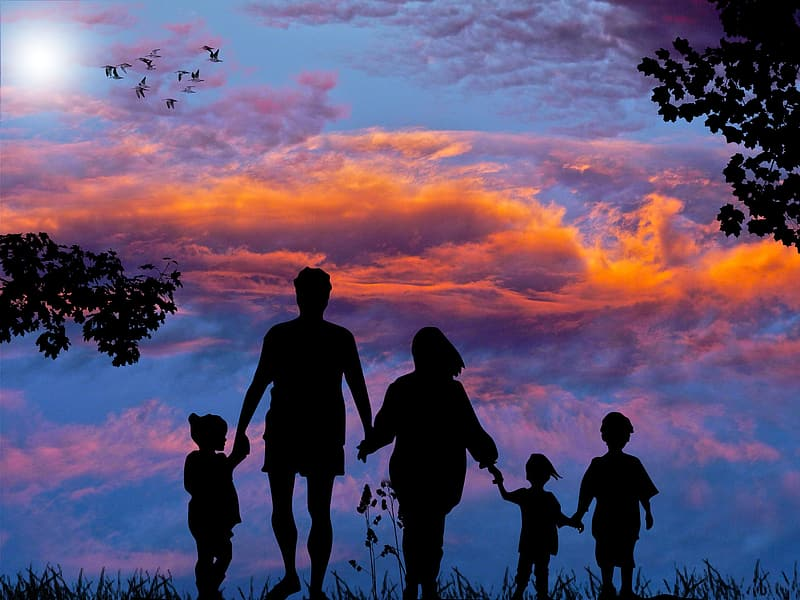 Silhouette of family during sunset
