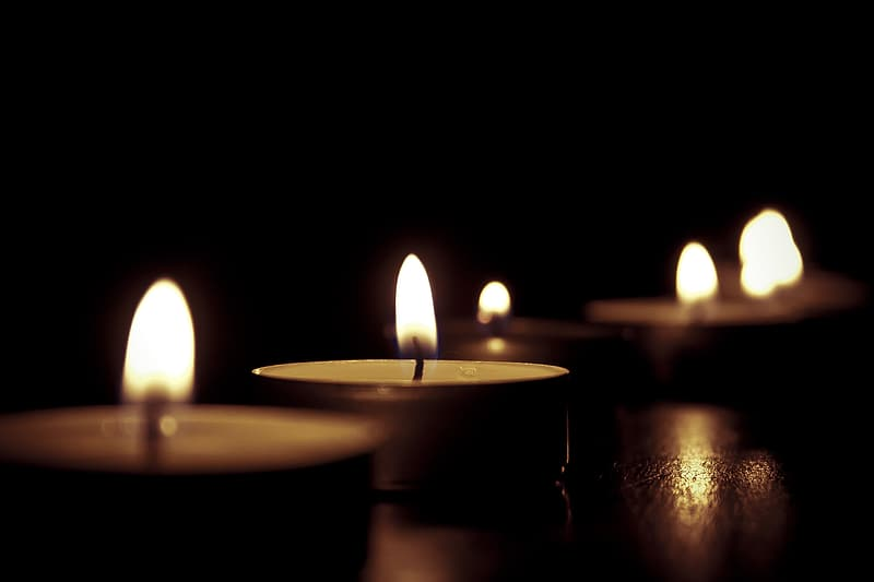 Depth of field photography of lighted candle