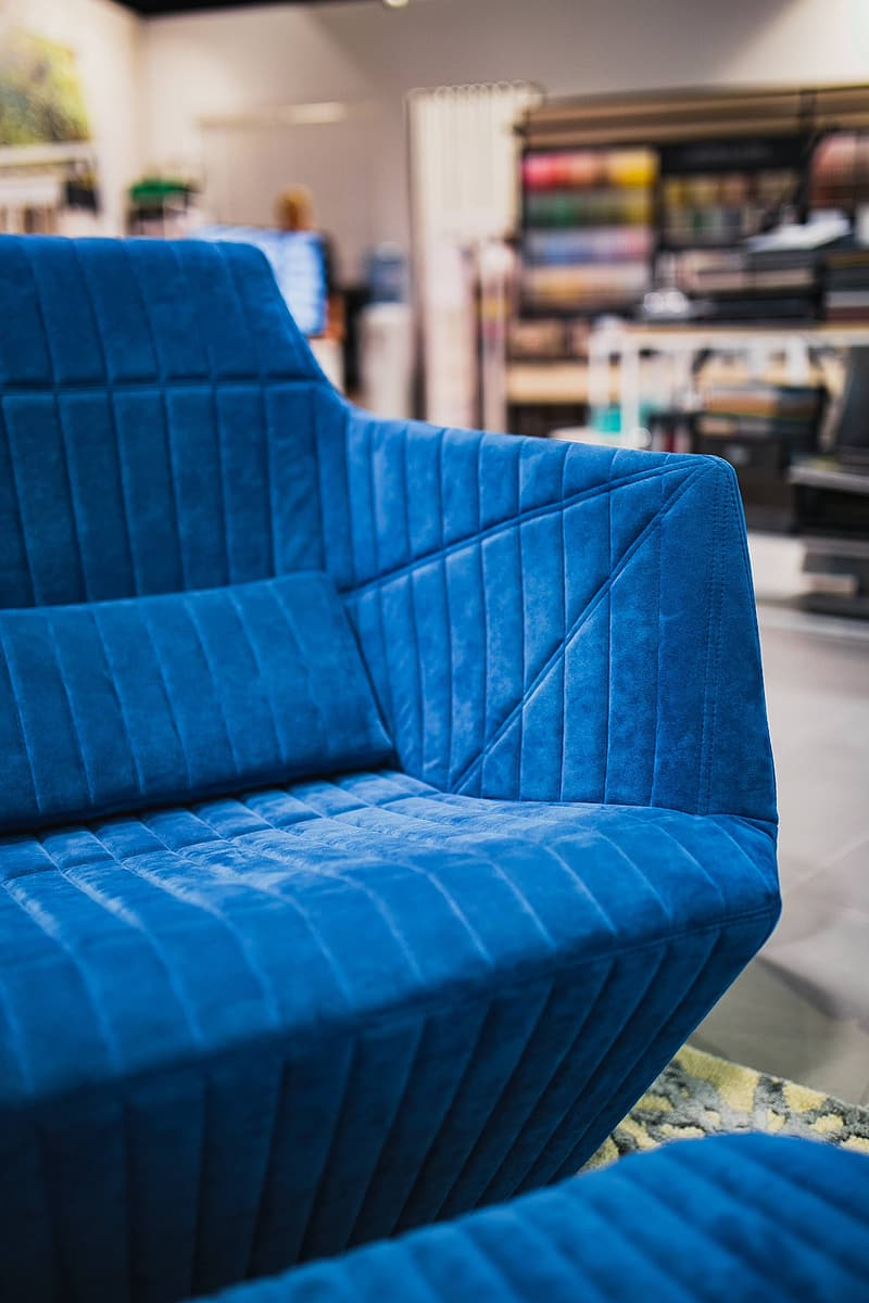Blue sofa chair in room