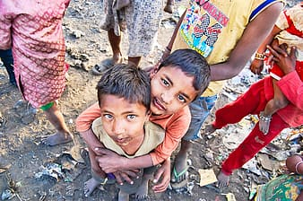 Two boys looking up on camera