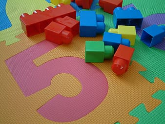 Assorted-colored interlock toys on jigsaw mat