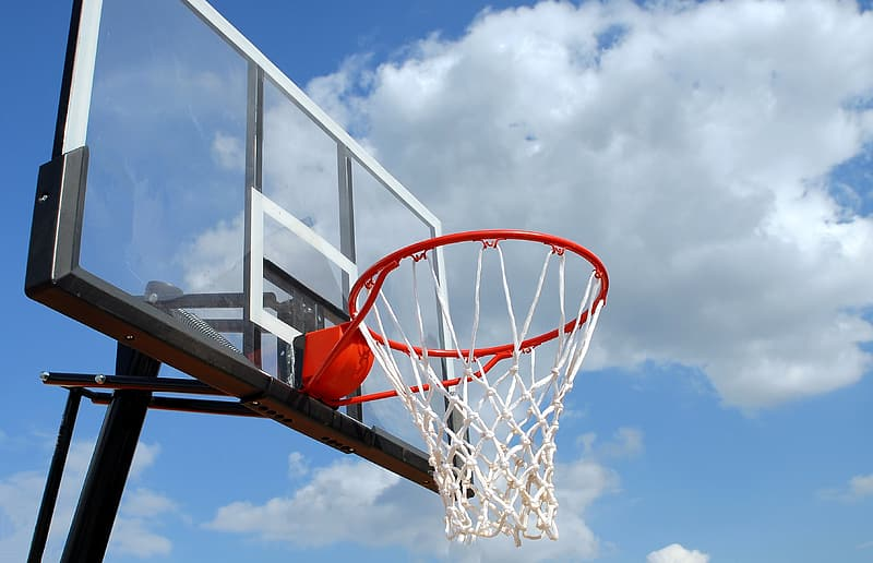 Blue and white basketball system overlooking the white clouds
