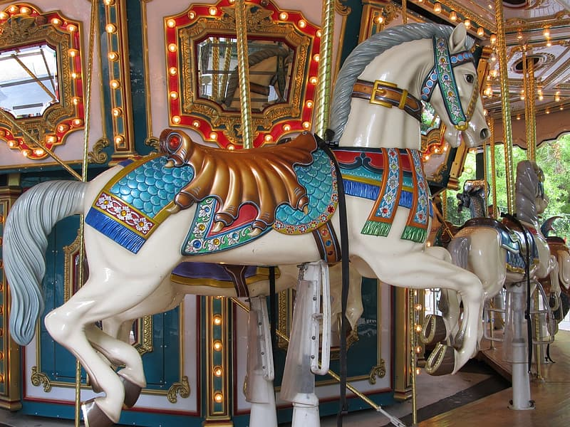 White and teal horse carousel