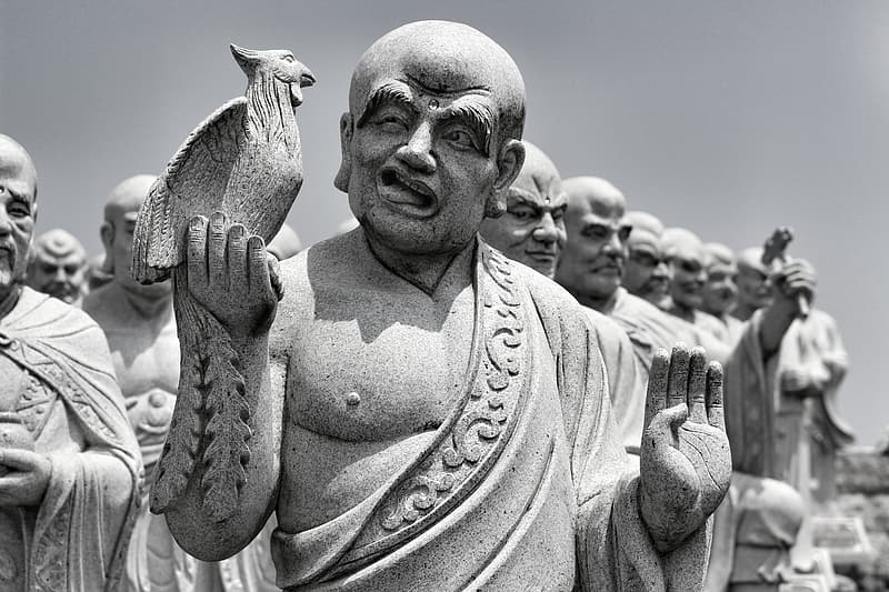 Man with bird on his shoulder statue
