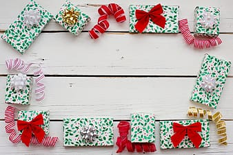 White red and green polka dot ribbon on white wooden fence
