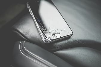 Cracked space gray iPhone 6 on black leather textile