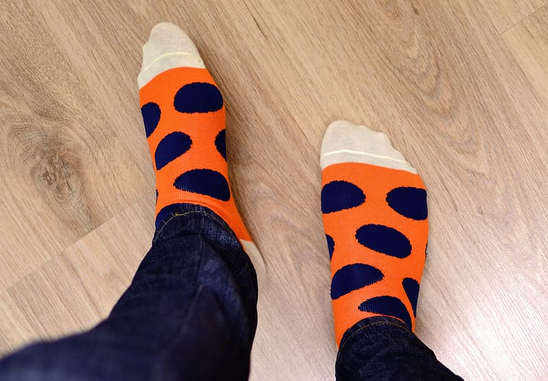 Person in orange and blue socks