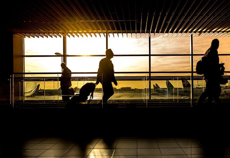 Man on airport during sunset