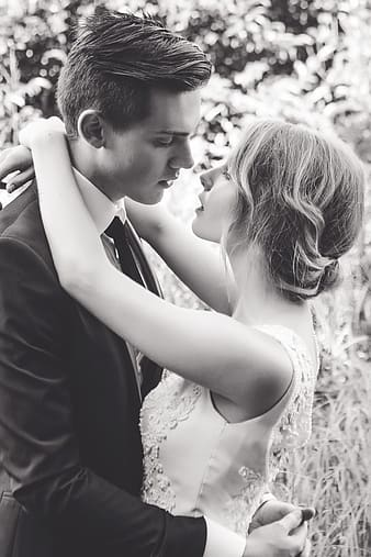 Grayscale photography of newly wed couple hugging each other