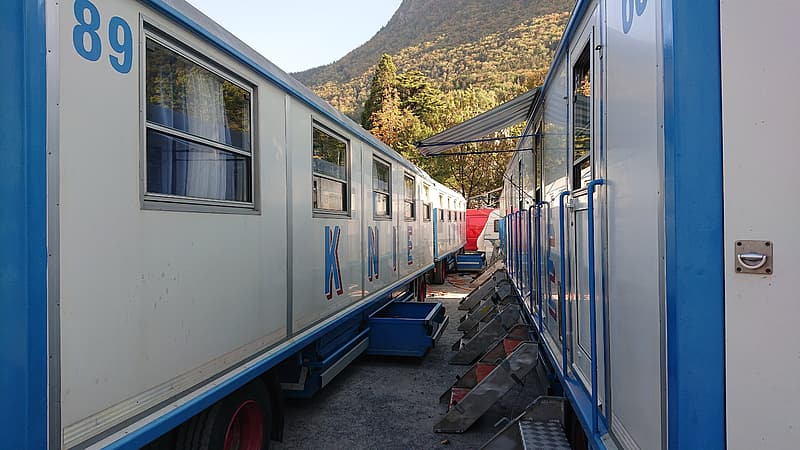 Blue and white train on rail during daytime