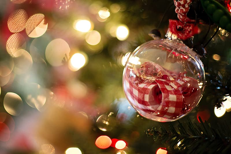 Clear glass bauble with red ribbon