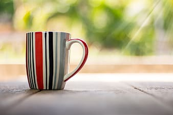 Red, black, and gray striped ceramic mug
