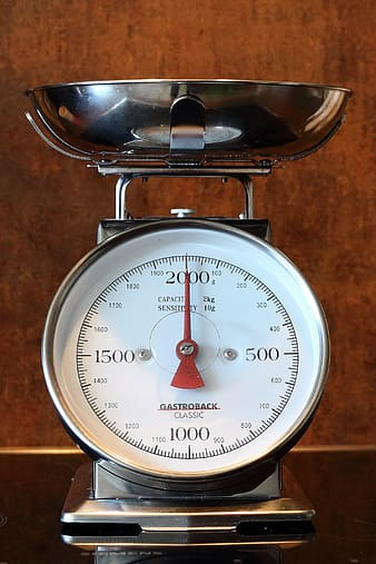 Gray stainless steel analog scale at 2000
