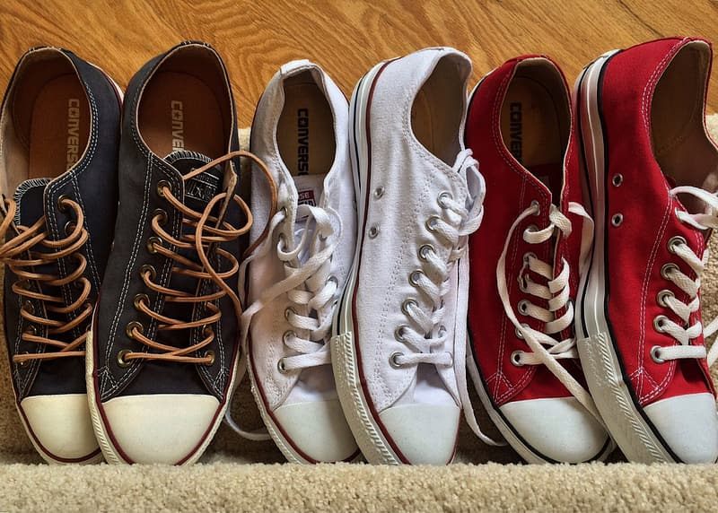 Pairs of black, white, and red low-top sneakers