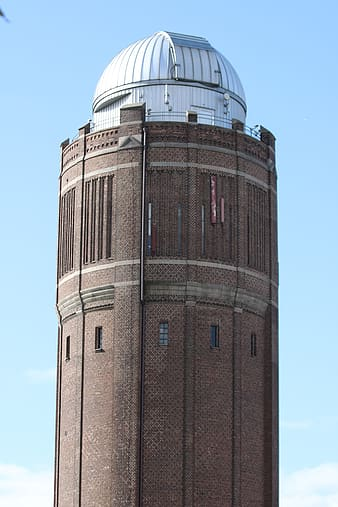 Brown and white telescope tower