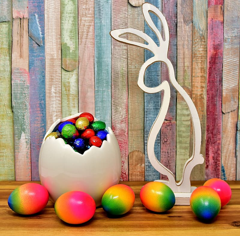 Easter eggs beside rabbit figure