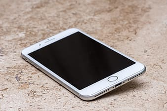 White samsung android smartphone on brown marble table