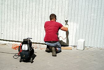 Man painting on wall