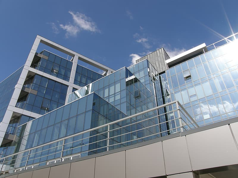 Clear glass and gray concrete building in low angle photography