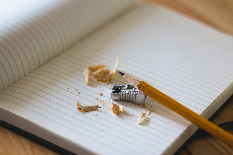 Pencil with gray sharpener on notepad