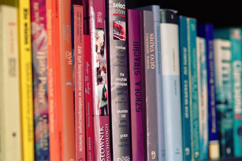 Close up photography of of pile of books