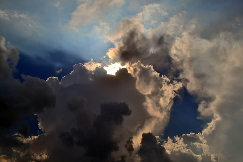Photo of sun covered by clouds