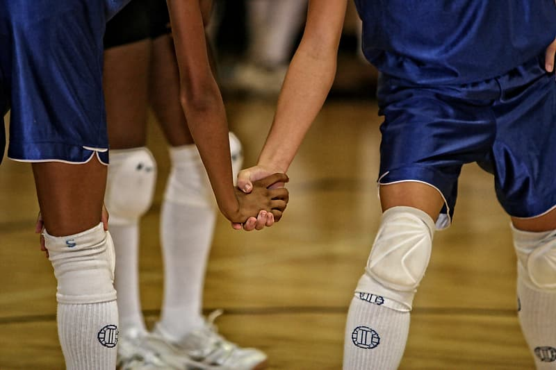 Two player holding their hands