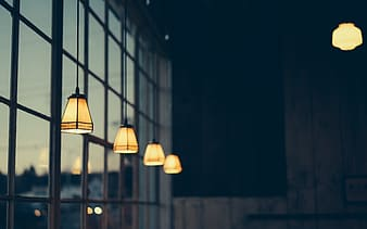 White pendant lamps turned on during night time