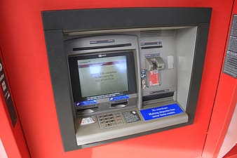 Grey and red ATM machine turned-on