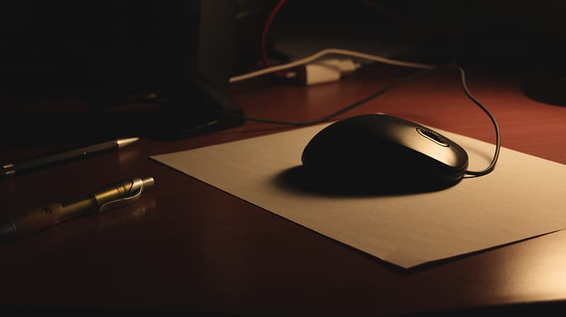 Black corded computer mouse on mouse pad