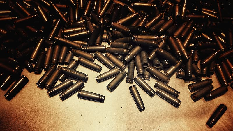 Bullet cartridge lot on brown textile