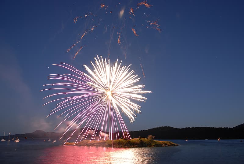 Time lapse photography of fireworks above island