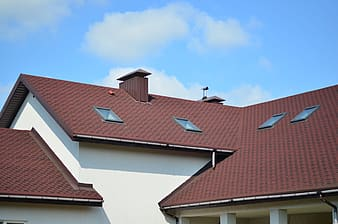 Brown brick roof with attic and chimney
