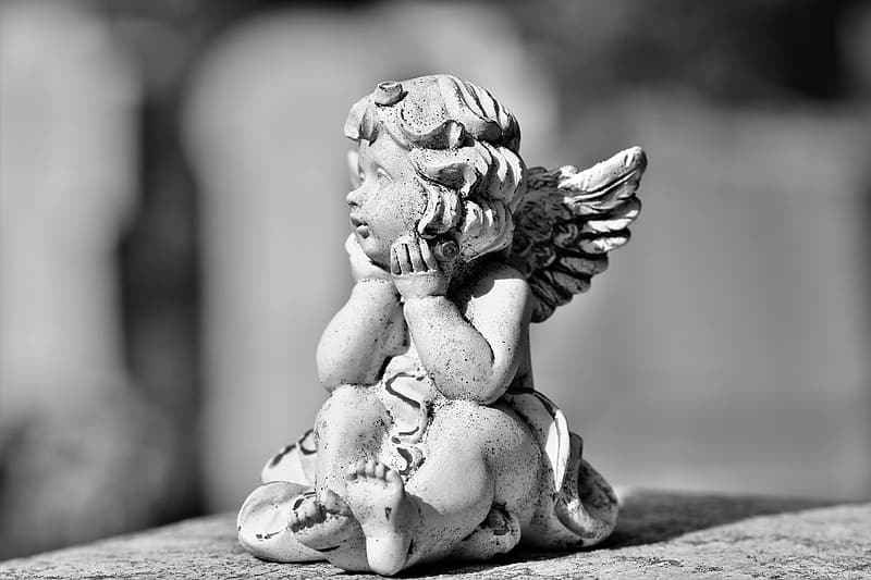 Gray concrete angel statue on gray scale photography