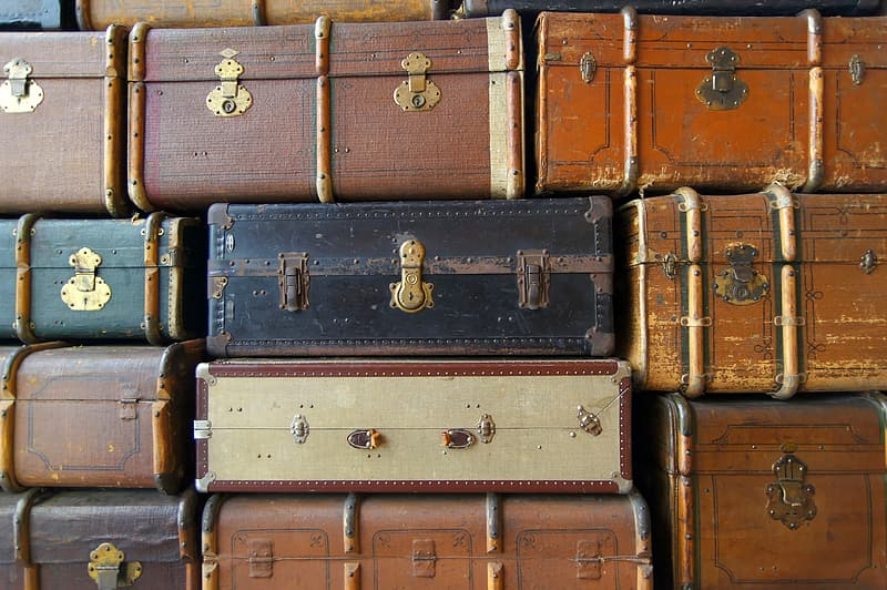 Brown and gray suitcase on white ceramic tiles