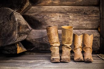 Pairs of brown leather boots