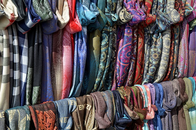 Hanging assorted-colored scarves