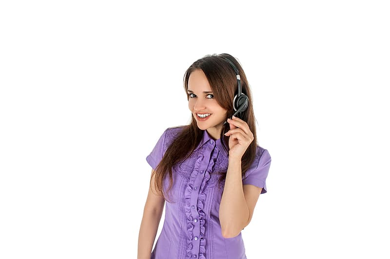 Woman wearing purple button-up blouse with headset