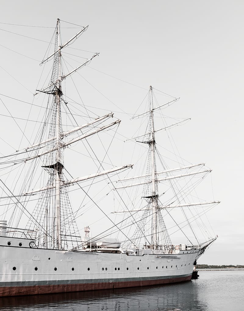White ship on body of water during daytime