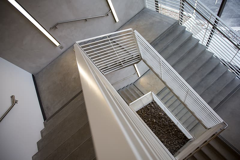 Gray and white stair inside the building