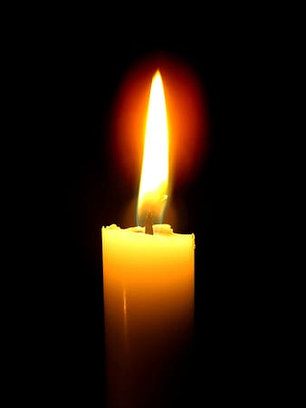 Lighted yellow candle