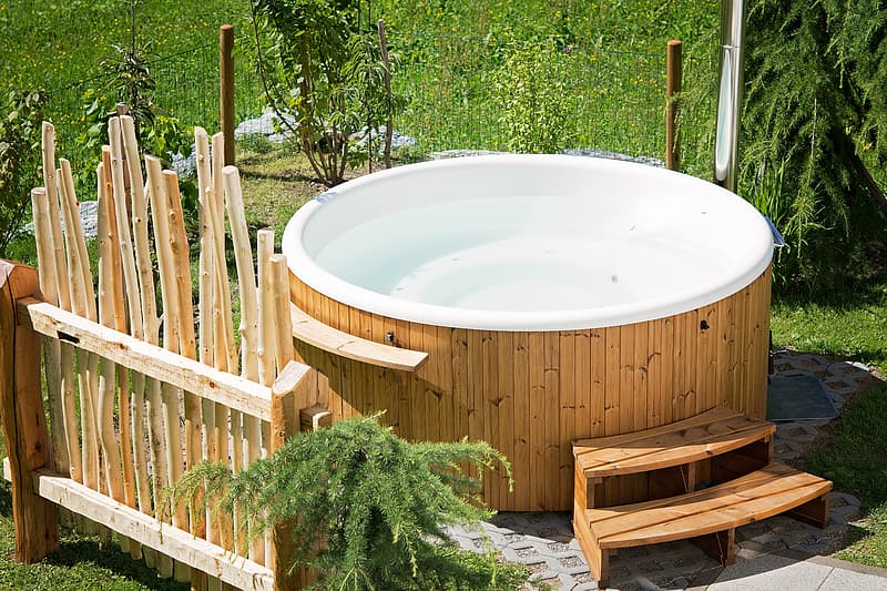 Brown wooden and white ceramic hot tub