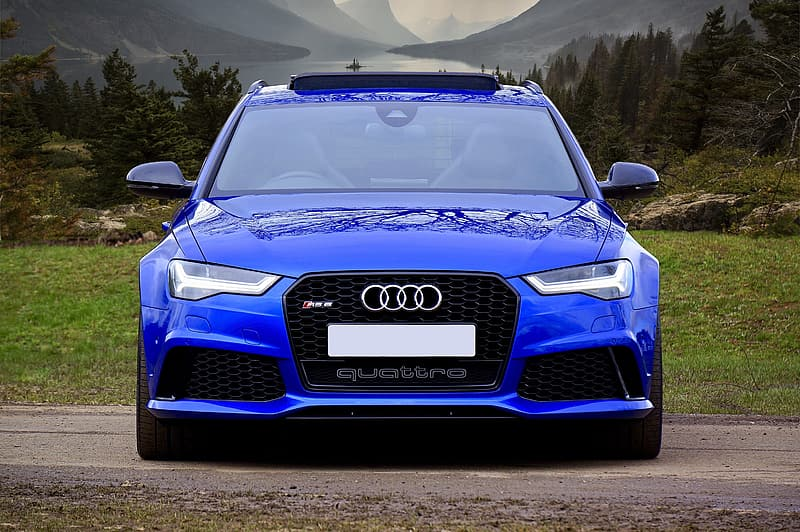 Blue audi a 4 on road during daytime