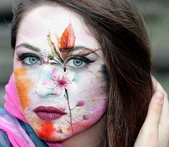 Pink flower printed on woman's face