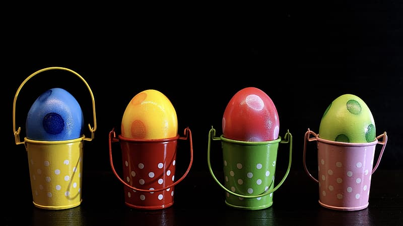 Yellow and pink egg in yellow and black polka dot basket