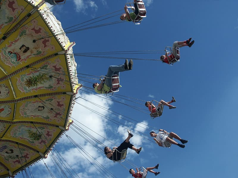 Group of people riding hanging swing carnival ride