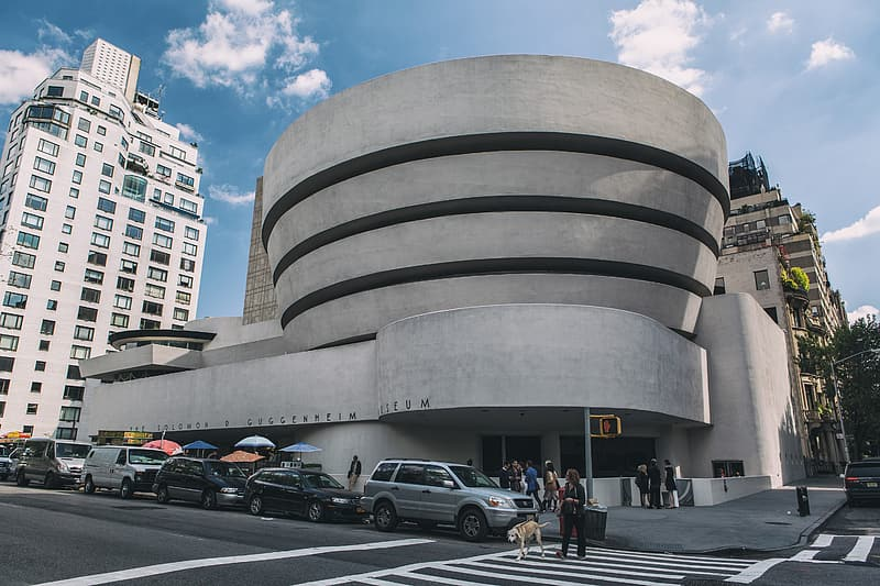Wide angle street shot of the exterior of the Guggenheim Museum in Manhattan, New York City