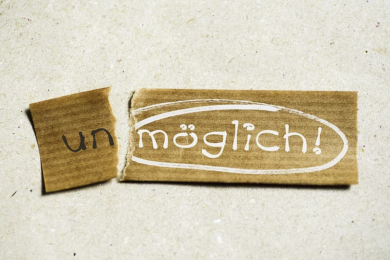 Brown textile with Un moglick! text