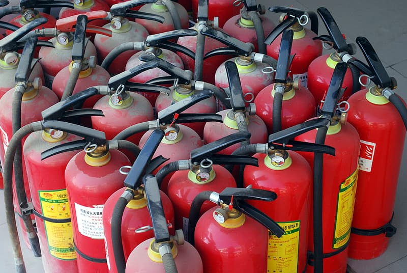 Red fire extinguisher tank lot on road